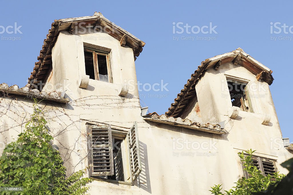two weathered mediterranean historic facade  roofs in  Croatia royalty-free stock photo