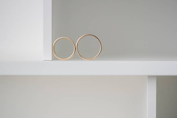 Two wedding rings on a white background.. Mr. and Mrs stock photo