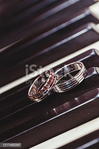 Wedding rings on piano keys.