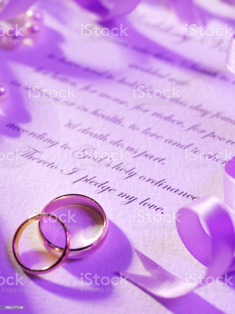 Two Wedding Rings On Vows Royalty Free Stock Photo