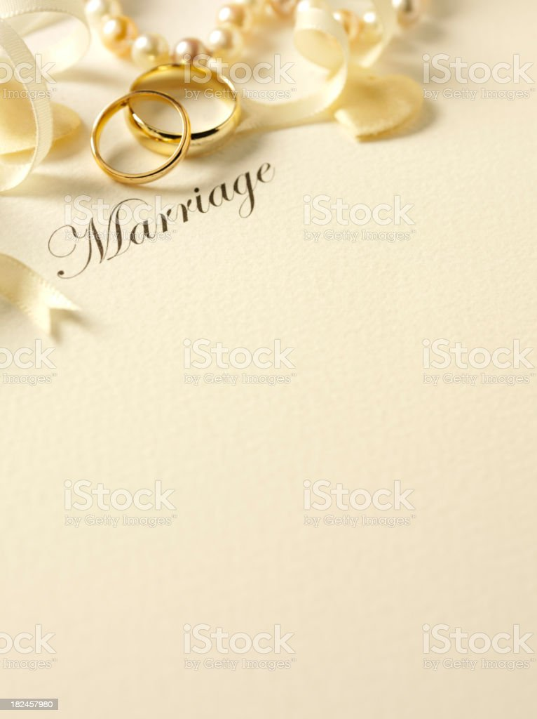 Two Wedding Rings with Ribbon and Pearls royalty-free stock photo