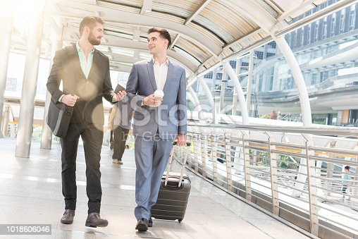 522304914 istock photo Two Westerner Business men talk with paper cup of hot coffee in hands 1018606046