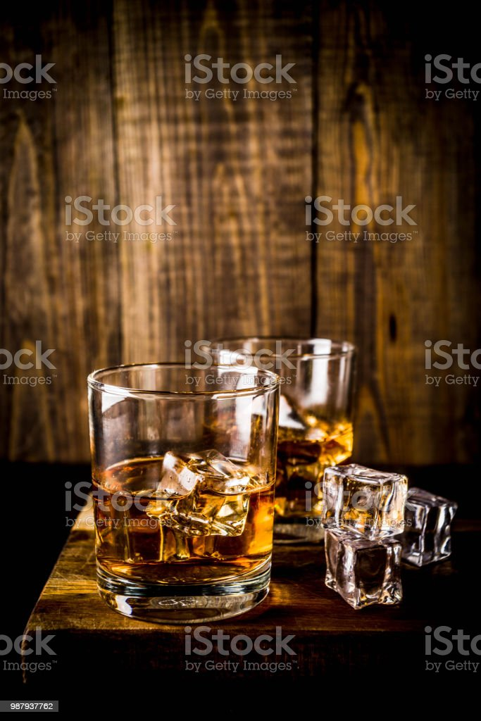 Two whiskey shot glasses stock photo