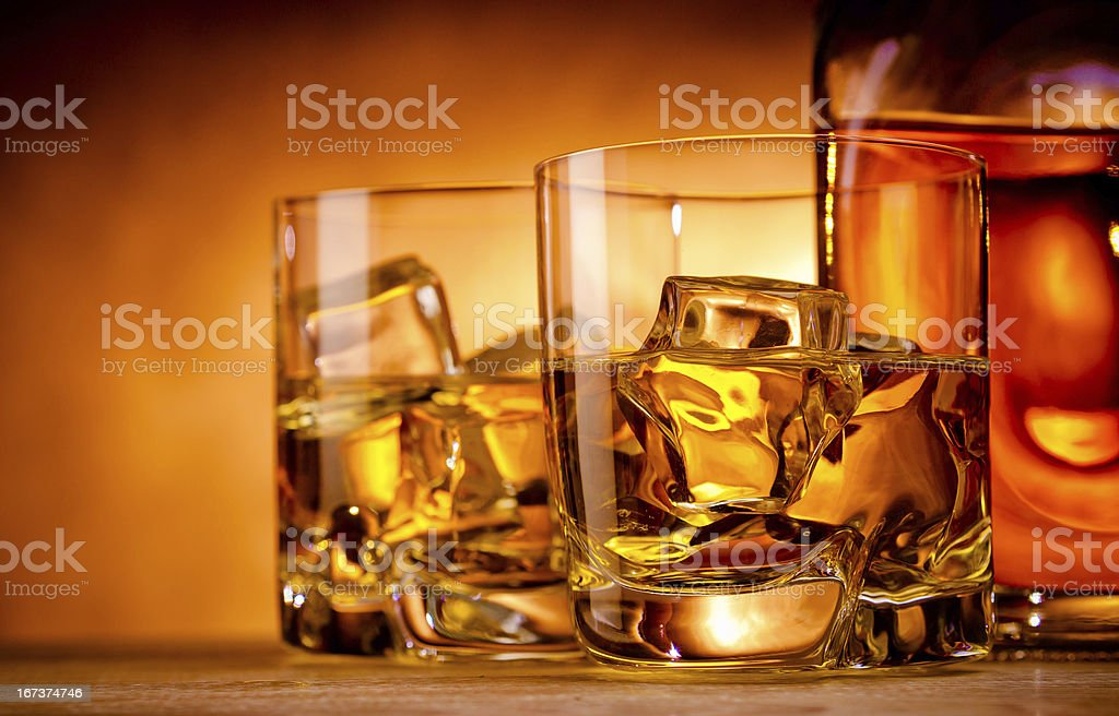 Two whiskeys and a bottle stock photo