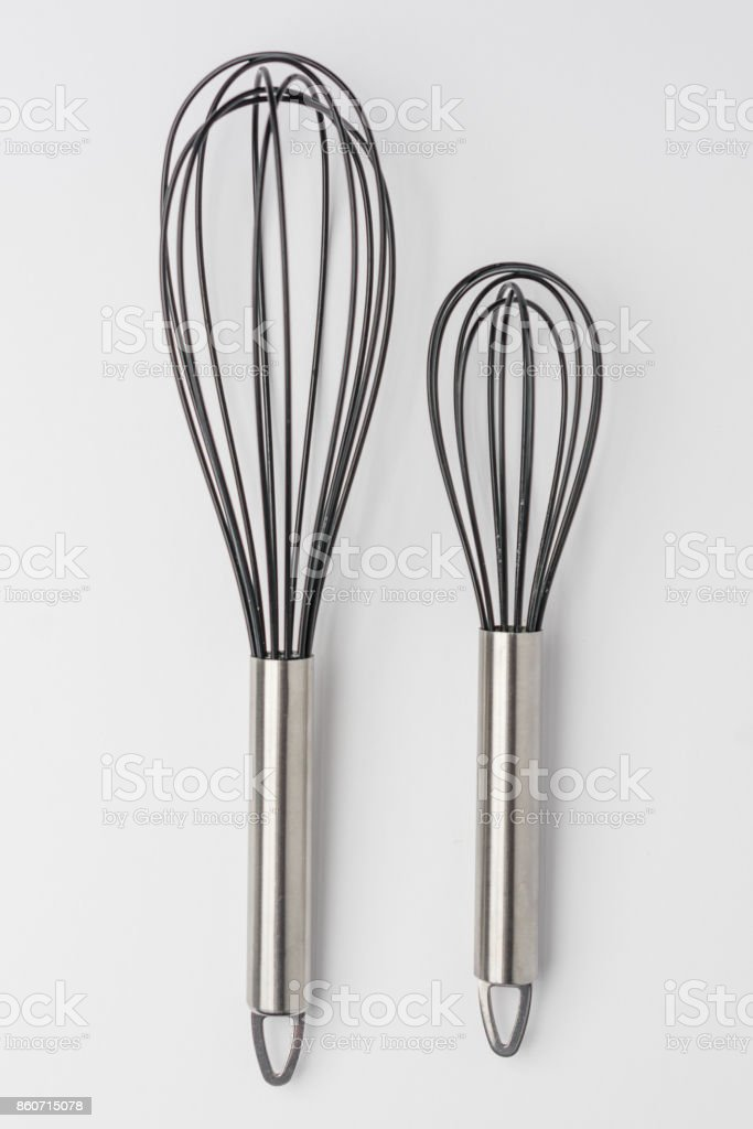 Two Whisks on White Background Top View stock photo