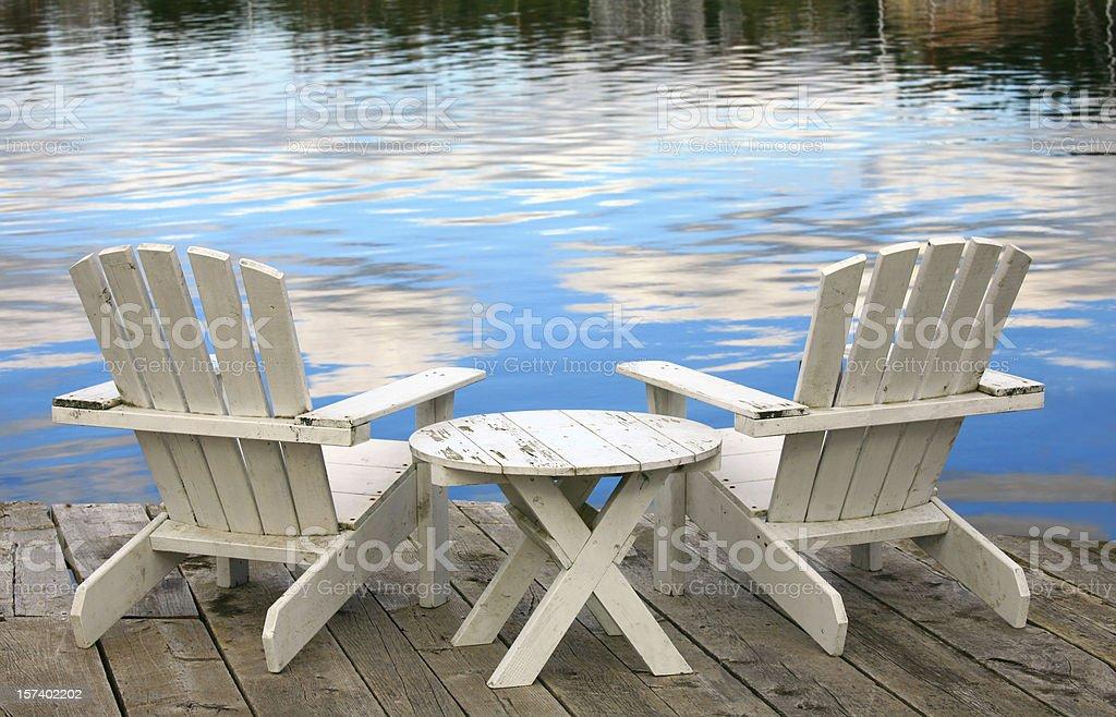 Two White Adirondack Chairs stock photo