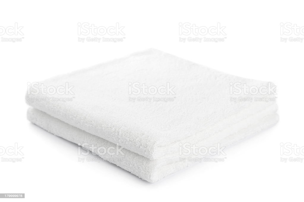 Two white bath towels neatly folded on a white background royalty-free stock photo