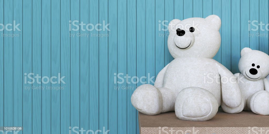 Two White Bear Dolls And Wall stock photo