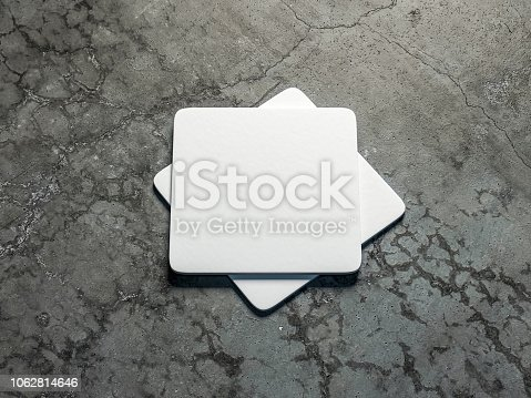 Two White beer coasters Mockup on the concrete floor. 3d rendering