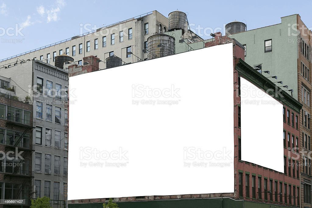 Two white blank billboard on the brick wall building. stock photo