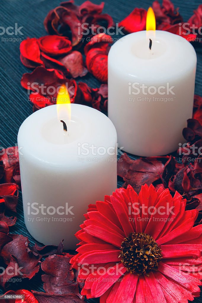 Two white candles burning on a blue background royalty-free stock photo