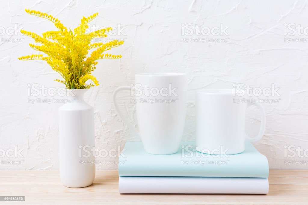 Two white coffee and cappuccino mug mockup with ornamental grass royalty-free stock photo