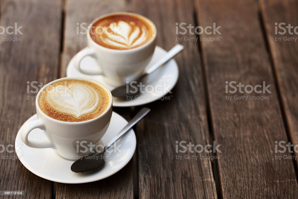 Two white cups of cappuccino stock photo