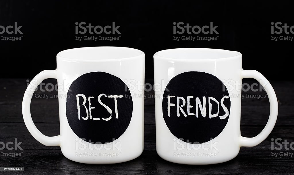 two white cups with the inscription stock photo