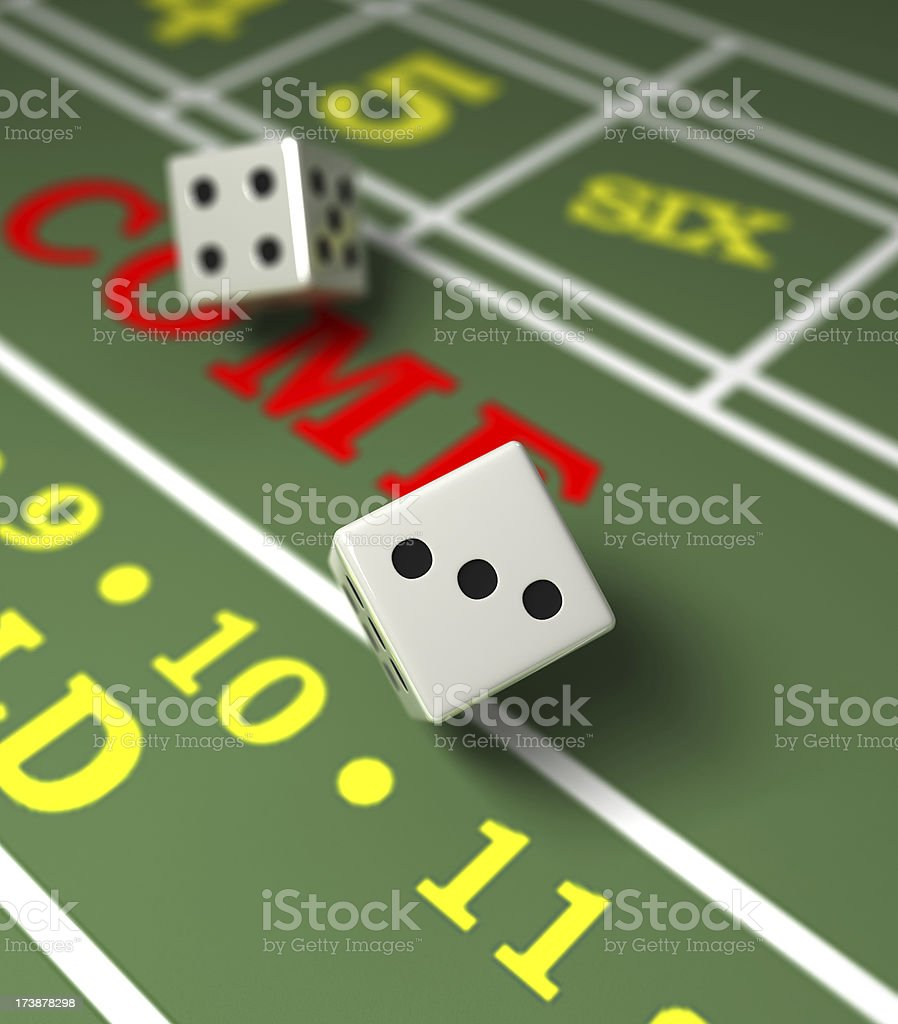 Two white dice in a game of craps royalty-free stock photo