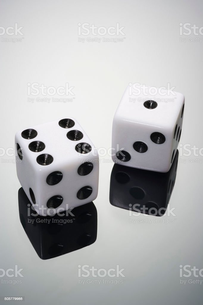Two white dice on grey background stock photo