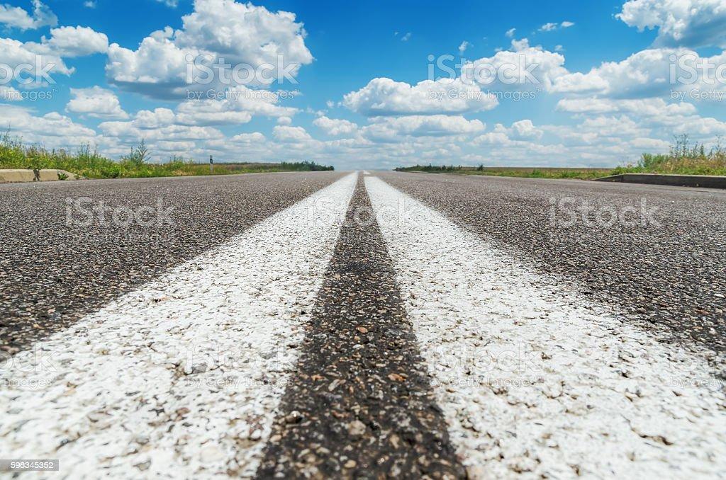 two white line on asphalt road closeup Lizenzfreies stock-foto