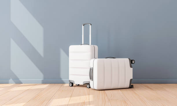 two white luggage mockup in empty room, suitcase, baggage - luggage stock photos and pictures