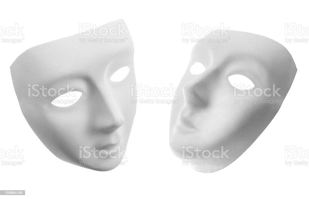 Two white masks isolated on white stock photo