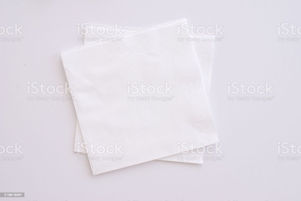two white napkins on white background - studio shot stock photo