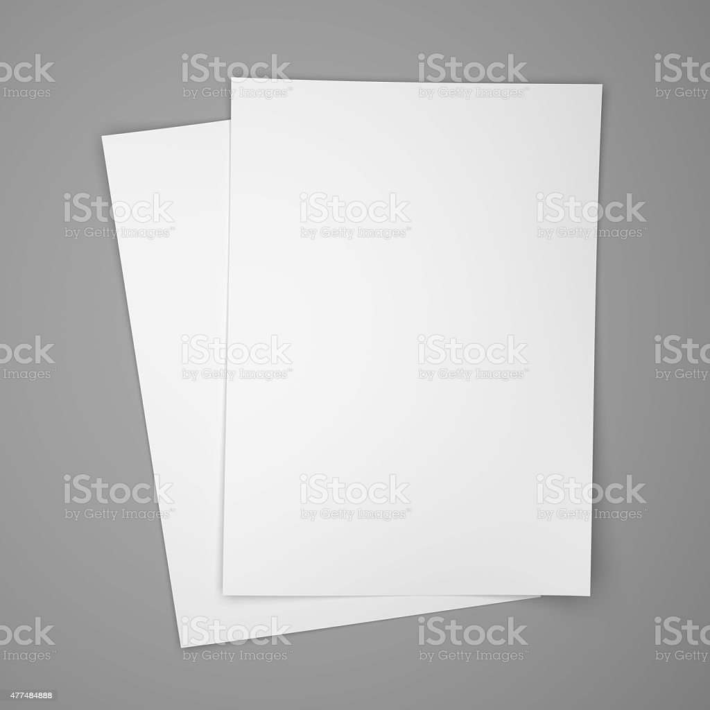 Two white paper sheets on gray stock photo