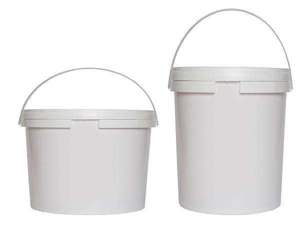 two white plastic buckets - kunststoff behälter bemalen streichen stock-fotos und bilder