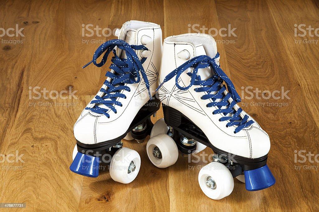 Two white roller skates stock photo