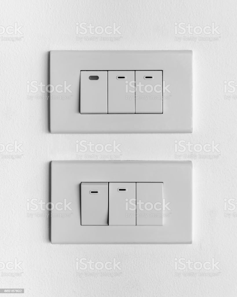 Two White Sets Of Triple Lighting Switches On Concrete Wall On And ...