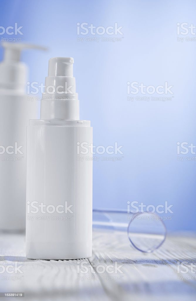 two white skincare sprayres on wooden table royalty-free stock photo