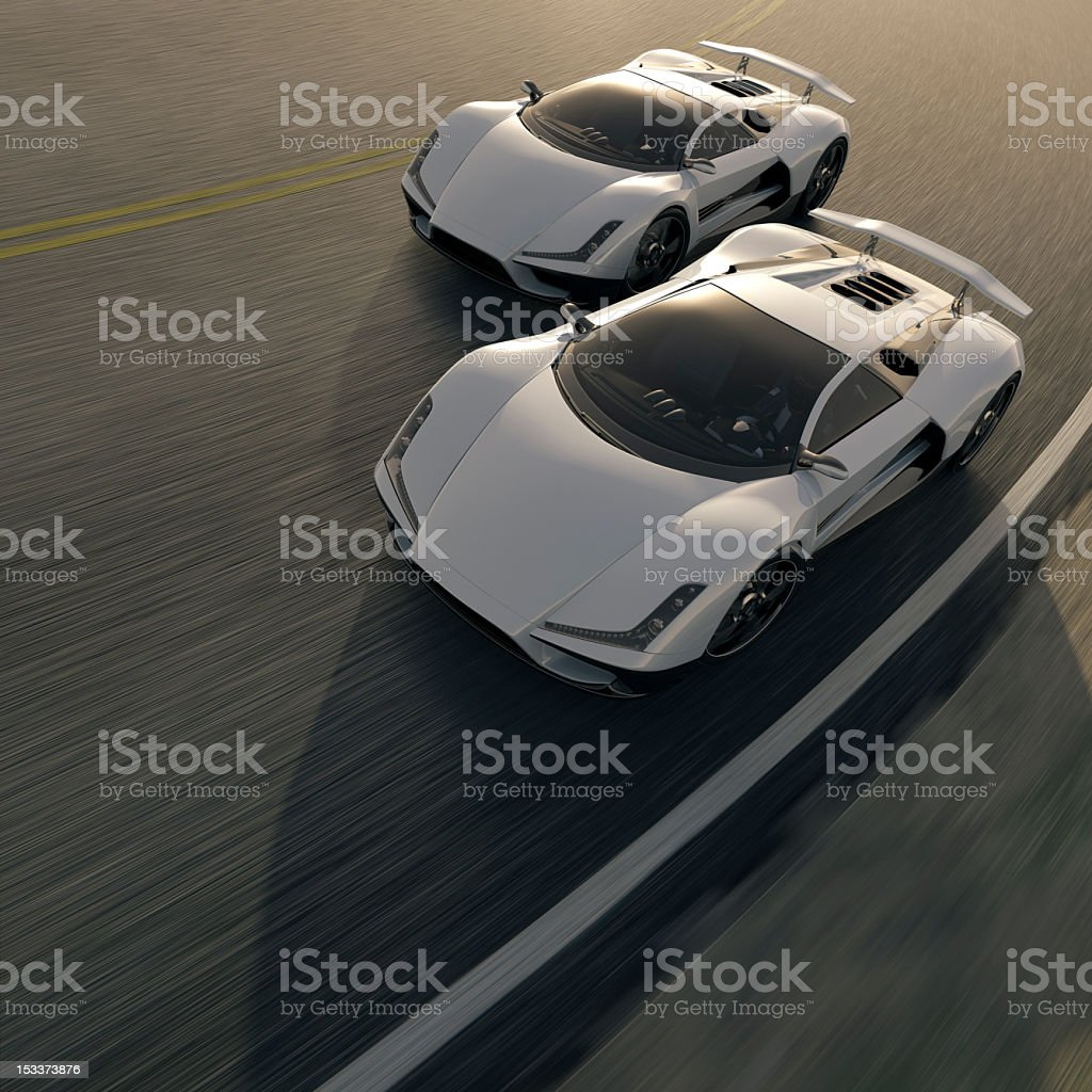 Two white street cars having a competition on the road stock photo
