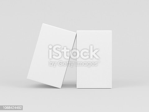 istock Two White textured boxes packaging mockup for fragrance or perfume isolated in gray studio 1068424452