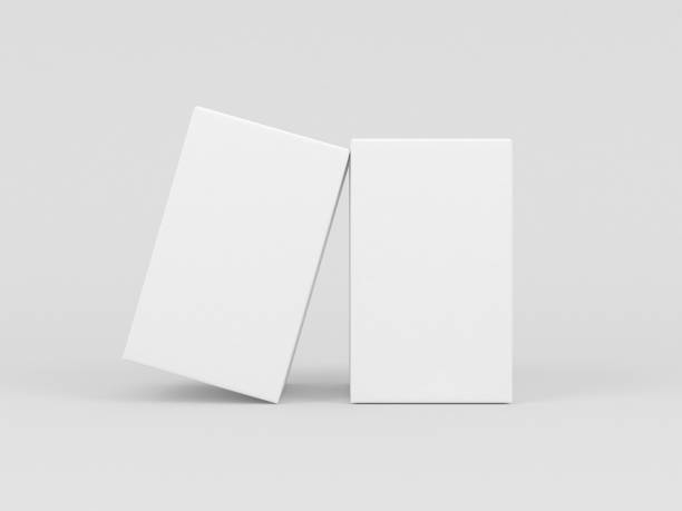 two white textured boxes packaging mockup for fragrance or perfume isolated in gray studio - packaging foto e immagini stock