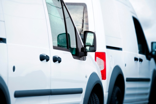 Two White Vans In A Parking Lot Stock Photo - Download Image Now