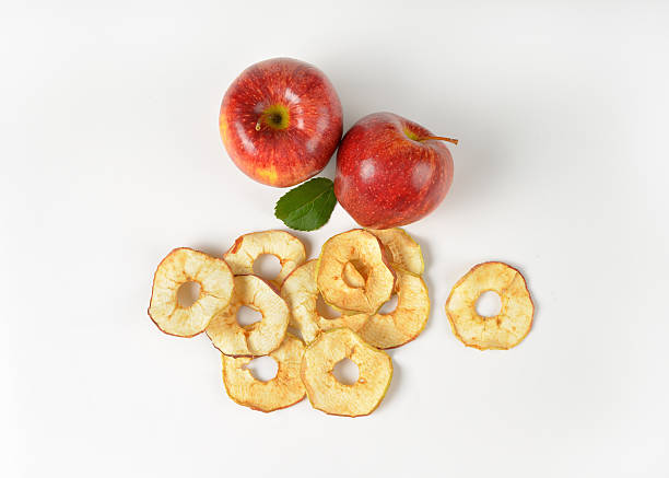 two whole apples and dried apple rings bildbanksfoto