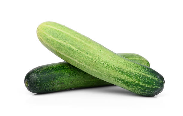 two whole cucumbers isolated on white background - cucumber stock photos and pictures