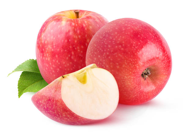 Two whole pink apples and a slice isolated on white stock photo