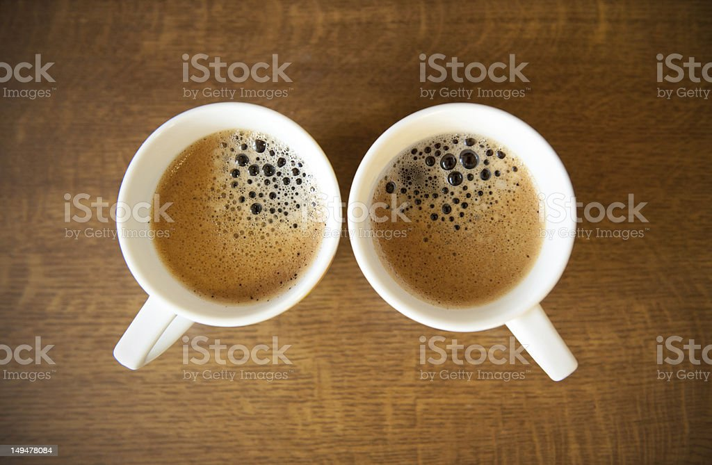 Two whte cups with espresso stock photo