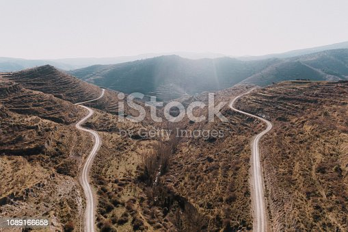 Two almost parallel winding roads in a mountain area in Spain