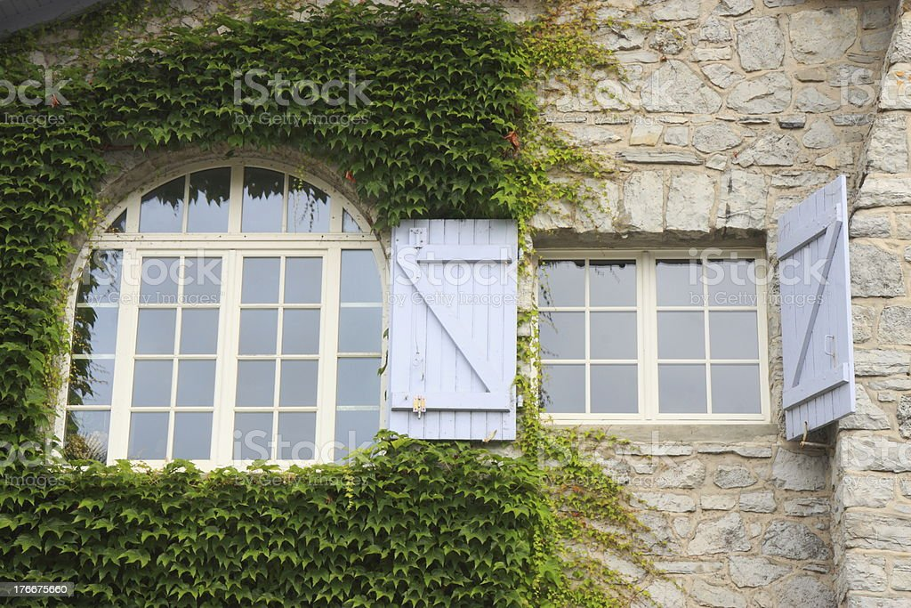 Two windows in french house facade royalty-free stock photo