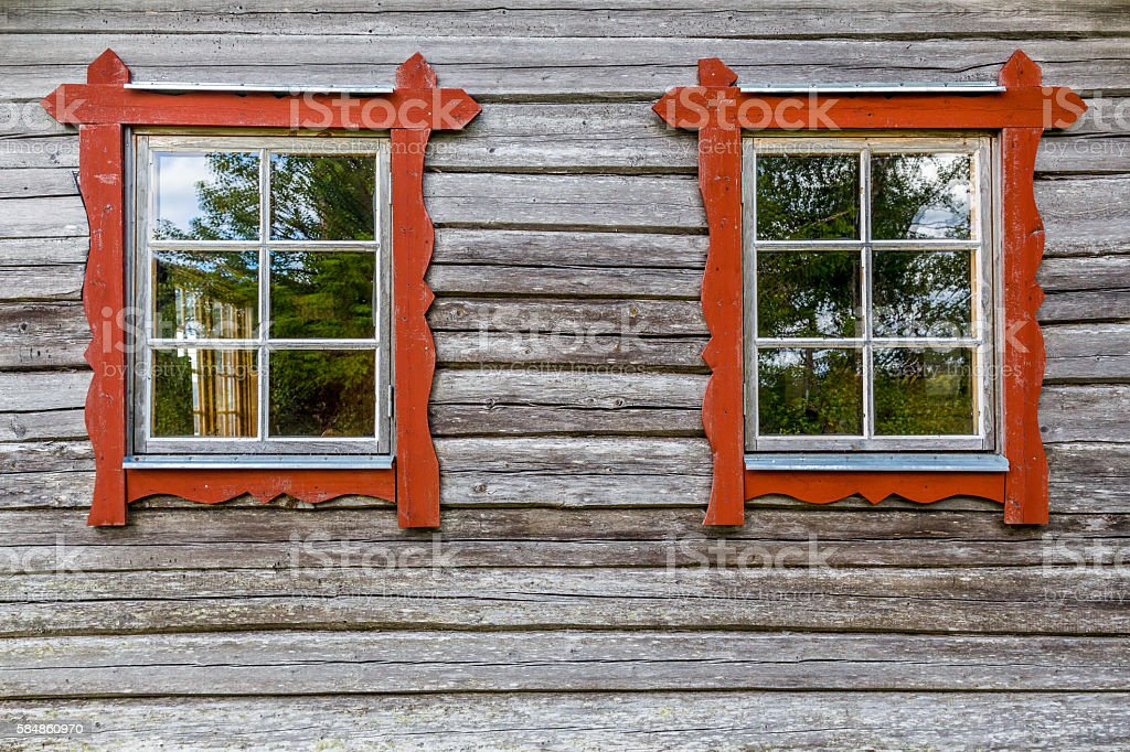 Two windows on log house wall, traditional style. stock photo