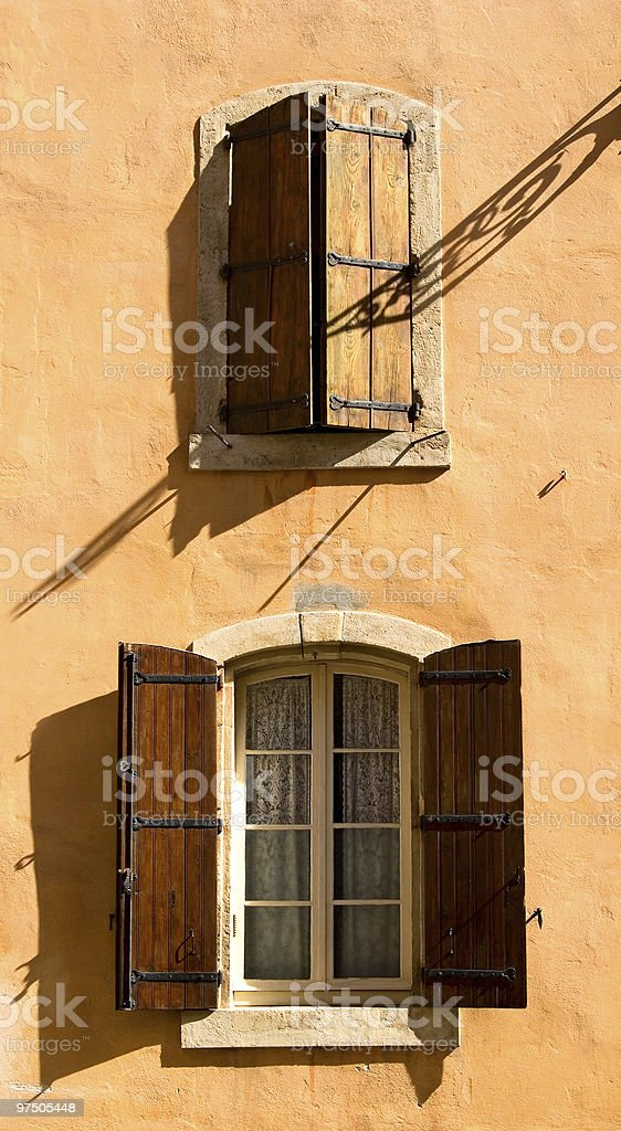 Two windows with shutters royalty-free stock photo