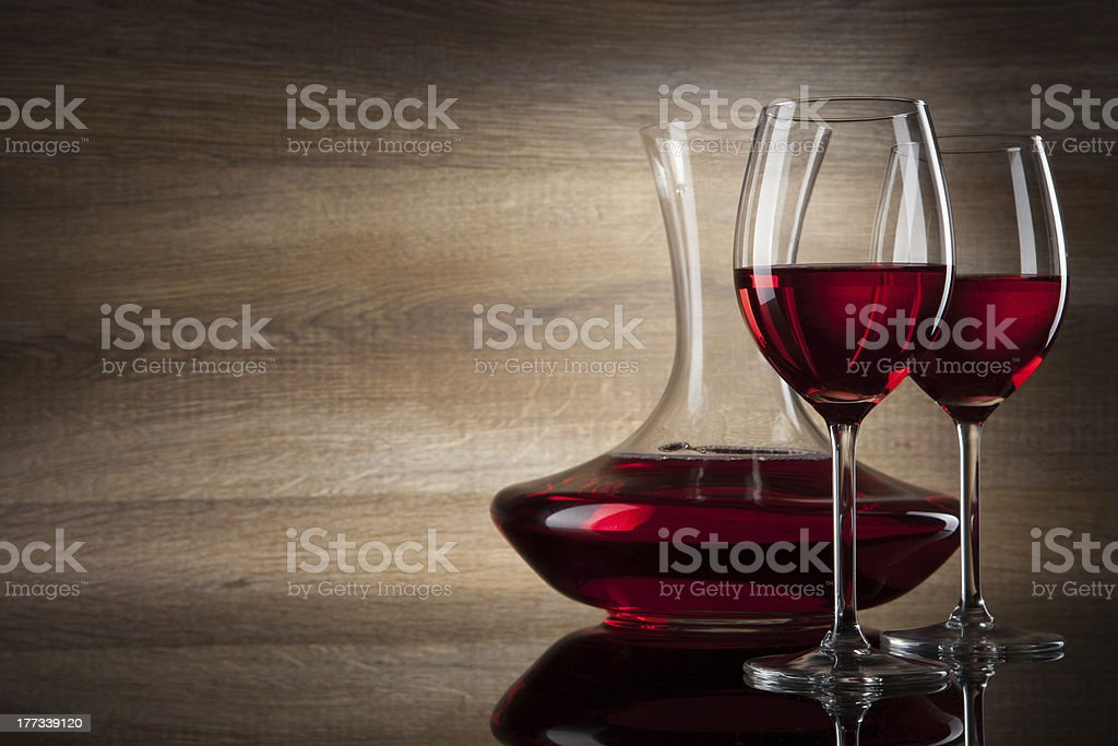 two Wine glass and decanter on a wooden table stock photo