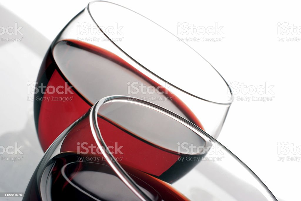 Two wine glasses half full of red wine royalty-free stock photo