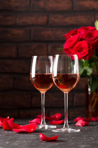 Two wine glasses of rose wine on dark background red roses by side picture id996472106?b=1&k=6&m=996472106&s=612x612&w=0&h=5xyb3a kkdmvbezwm98fxddq4lsmnna4uuzd3ianilm=