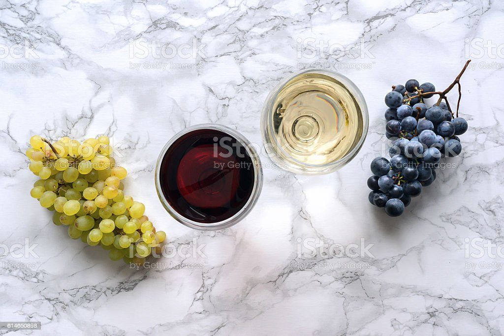 Two wine glasses  on marble table stock photo