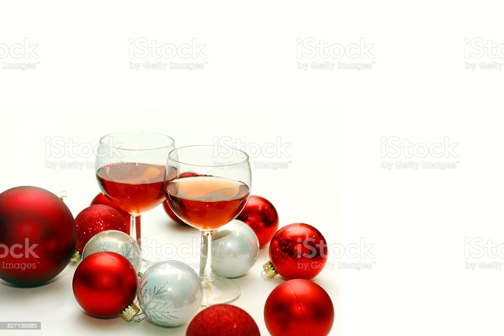 two wine glasses surrounded by christmas decorations royalty free stock photo