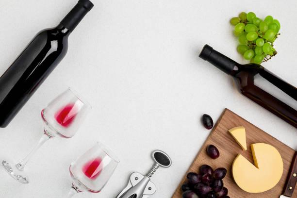 Two wine glasses with red winebottle of red wine and cheese on white picture id693238110?b=1&k=6&m=693238110&s=612x612&w=0&h=krhtxda2kac3yiyw utpdcufypxakbkjdnvt6kdez1i=