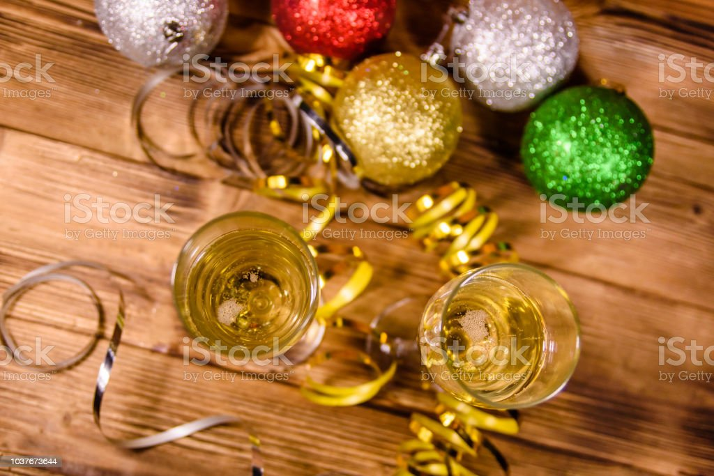 Two Wineglasses With Champagne And Different Christmas Decorations On Wooden Table Top View Stock Photo Download Image Now