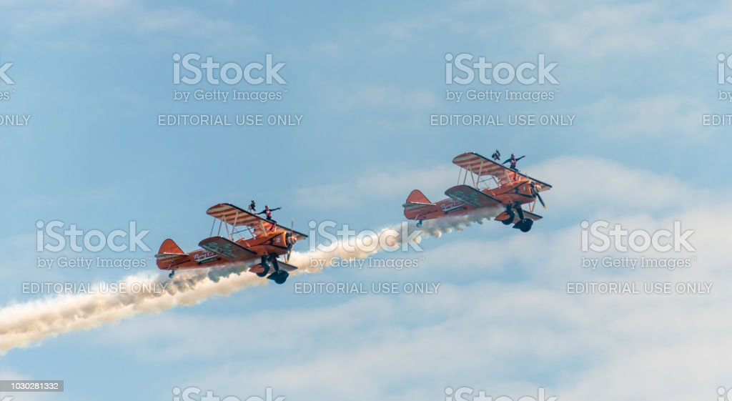 Two wing walkers on old biplanes at the Bournemouth Air Festival stock photo