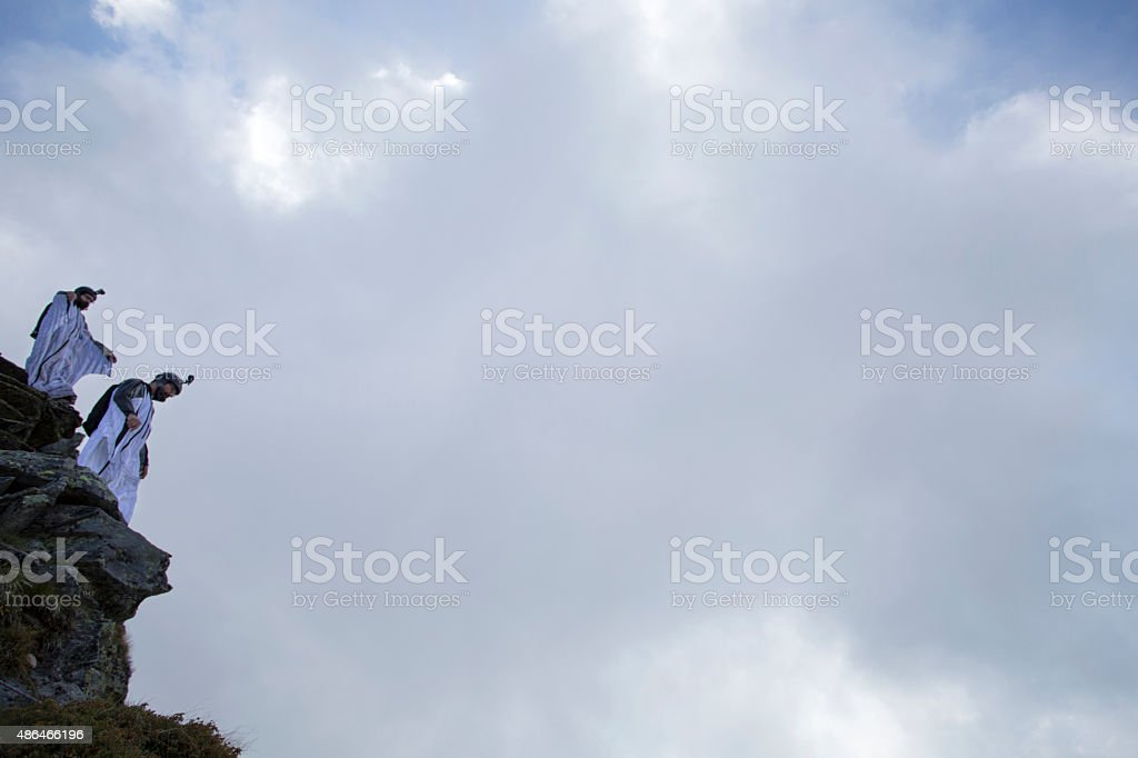Two wingsuit jumpers about to launch stock photo